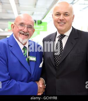 Secretary of State for Work and Pensions Iain Duncan Smith meets 76 year old Roy Gill, the oldest employee at the Asda store on London's Old Kent Road during his visit to the store to meet some employees and to discuss their experience of working past retirement.
