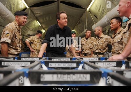 Prime Minister David Cameron meets soldiers work in the post office at Camp Bastion in Helmand Province during his - Stock Photo
