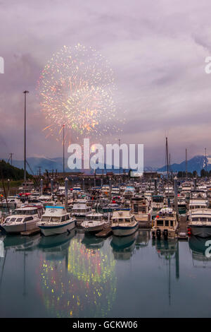 Independence Day fireworks over the boat harbor in Valdez, Southcentral Alaska - Stock Photo