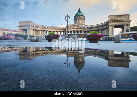 Russia, Saint-Petersburg, 03 July 2016: Reflection of Kazan Cathedral in a pool on the sidewalk of the Nevsky prospect - Stock Photo
