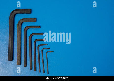 Hex key wrench set on blue table . - Stock Photo