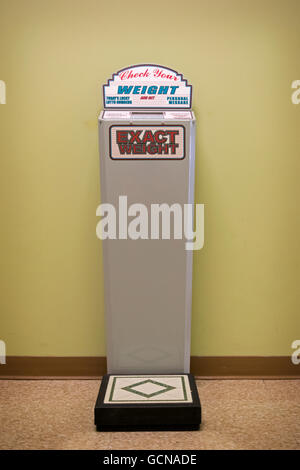 An old fashion weighing scale at the Tanger Outlet stores in Deer Park, Long Island, New York. - Stock Photo