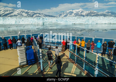 Tourists aboard the Coral Princess cruise ship view Hubbard Glacier and the St. Elias Mountains in Disenchantment - Stock Photo