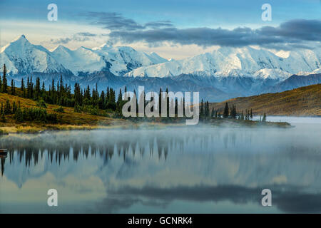 Scenic sunrise view over Mt. Brooks and the Alaska Range with fog over Wonder Lake in the foreground, Denali National - Stock Photo