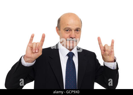 Amateur rock music at a business meeting. revive old. Elderly man in a suit shows a sign of the horns - Stock Photo
