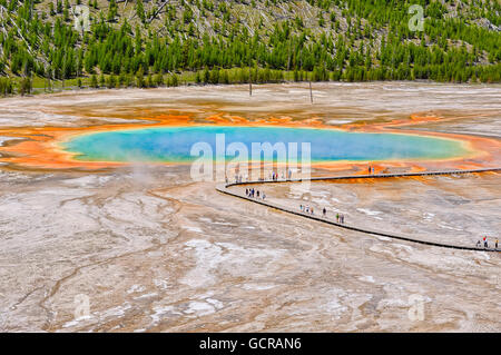 Visitors exploring the extraordinary colors and patterns for the Grand Prismatic Spring, Yellowstone National Park - Stock Photo