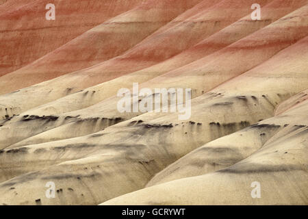 The Painted Hills in Oregon is one of the three units of the John Day Fossil Beds National Monument. - Stock Photo