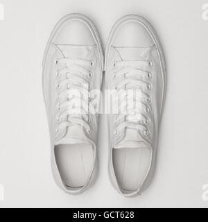 White sneakers on a white background - Stock Photo
