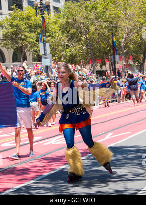 A woman roller skating as part of SF Supervisor London Breed group in San Francisco Pride Parade 2016 - Stock Photo
