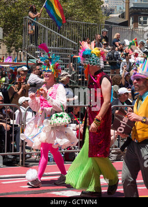 A group of people in colorful costumes parade at San Francisco Pride Parade 2016 - Stock Photo