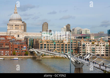 Skyline, pedestrians crossing Millennium Bridge over the River Thames, St. Paul's Cathedral, London, England, United - Stock Photo