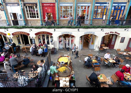 Restaurants and shops in a former market hall in Covent Garden district, people, London, England, United Kingdom, - Stock Photo