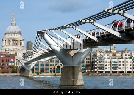 Pedestrians crossing Millennium Bridge over the River Thames, St. Paul's Cathedral, London, England, United Kingdom, - Stock Photo