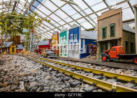 Miniature scale model railroad on display at Buffalo and Erie County Botanical Gardens in Buffalo New York - Stock Photo