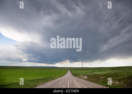 A storm over a dirt road near Slater, Wyoming, May 31, 2014. - Stock Photo