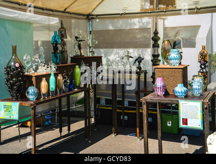 Booth at Cherry Creek Art Festival in Denver Colorado showing glass blown vases and sculptures crafted by Todd Cameron - Stock Photo