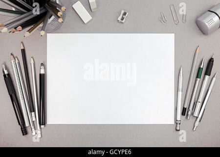office drawing tools. office workspace with blank paper sheet and various drawing tools top view stock photo d