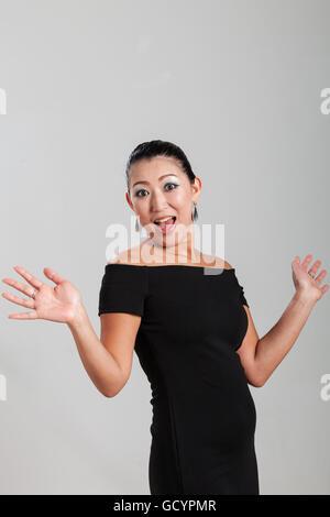 Elegant Asian woman in studio - Stock Photo