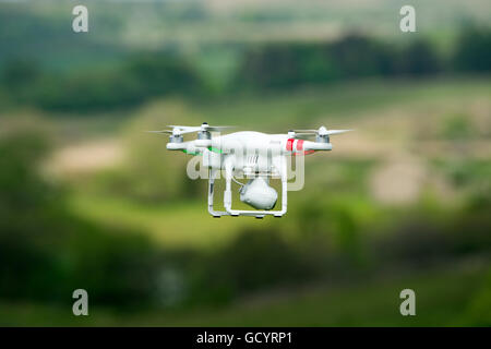 Camera drone in action in countryside, UK. - Stock Photo