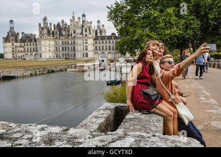 Tourists taking a selfie at Château de Chambord, Loir-et-Cher, France - Stock Photo