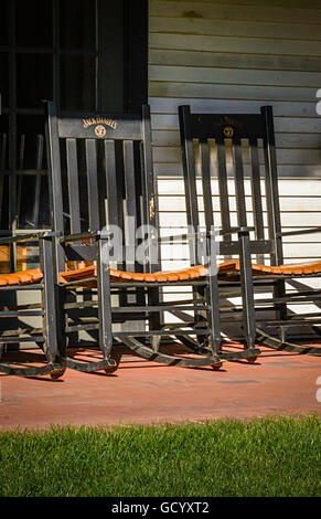 Several branded Jack Daniel's No 7 Black wooden rocking chairs on veranda of the Jack Daniel's Distillery in Lynchburg, - Stock Photo