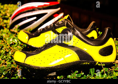 The yellow shoe standing on plant, Beautiful shoe on still nature background. - Stock Photo