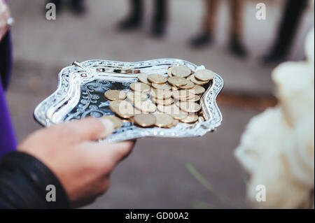 Investment and saving concept. coins in silver plate on white background. - Stock Photo