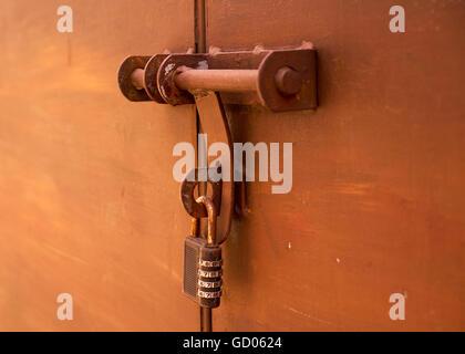 old lock on bronze metal garage door - Stock Photo