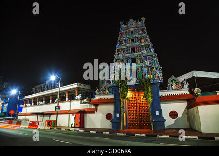 Sri Mariamman Temple at night in Singapore - Stock Photo