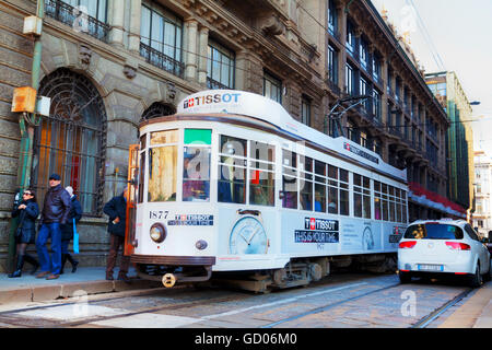MILAN, ITALY - NOVEMBER 24: Old tram with people on November 24, 2015 in Milan, Italy. - Stock Photo