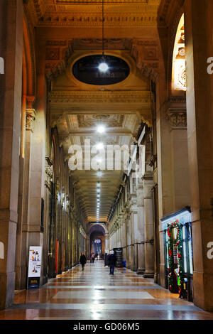 MILAN, ITALY - NOVEMBER 25: Galleria Vittorio Emanuele II shopping mall interior with people early in the morning - Stock Photo