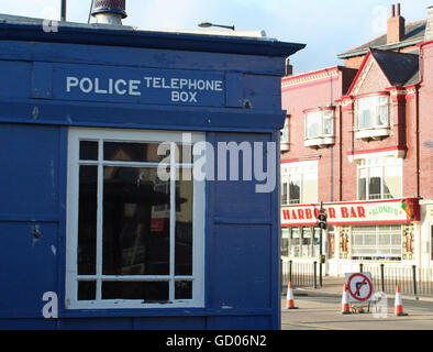 Police Telephone Box and Harbour Bar on Sandside, Scarborough - Stock Photo