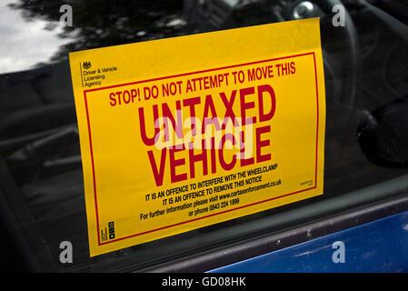 Untaxed vehicle sticker on a side window of a car in Edinburgh, Scotland, UK. - Stock Photo