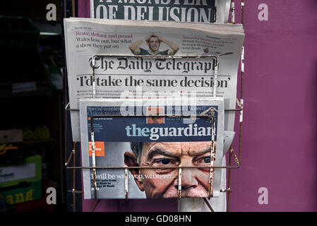 Front pages of The Guardian and Daily Telegraph on the day the Chilcot Inquiry findings were published. - Stock Photo