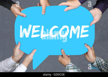 Group of people holding with hands the word welcome refugees refugee immigrants employee colleague - Stock Photo