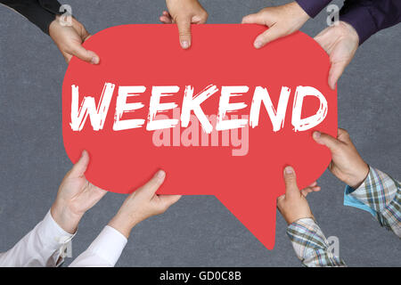Group of people holding with hands the word Weekend relax relaxed break business concept free time freetime leisure - Stock Photo