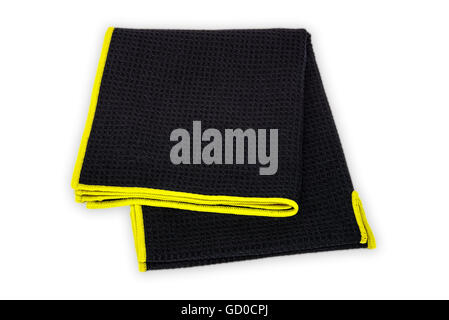 Black microfiber towel with non abrasive and lint free regatta yellow trim for sport on white background - Stock Photo