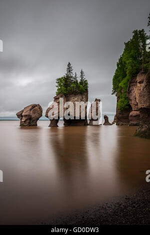 A long exposure of the Flowerpot Rocks, part of the Hopewell Rocks, in New Brunswick, Canada. - Stock Photo