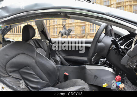 Westminster, London, UK. 11th July 2016. The remains of the car opposite Parliament in which Joseph Brown-Lartey - Stock Photo