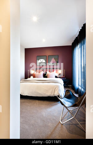 Entrance to a classic bedroom with a chair and black curtain in a luxury house - Stock Photo