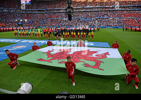 The Welsh Dragon flag is displayed in front of the Welsh football team during the national anthems at the Euro 2016 - Stock Photo