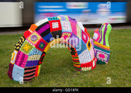 Loch Ness Monster Dragon with Colourful knitted decorations of a dragon part of Yarn bombing or yarnbombing, also - Stock Photo