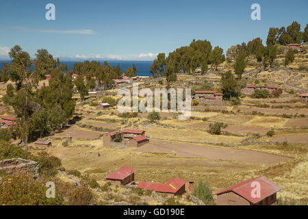 Houses of Local Peruvian People Living on Taquile Island (Isla Taquile) at Lake Titicaca  in Puno Peru. - Stock Photo