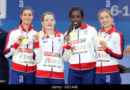 (L-R) Great Britain's Seren Bundy-Davies, Eilidh Doyle, Anyika Onuora and Emily Diamond celebrate after finishing - Stock Photo
