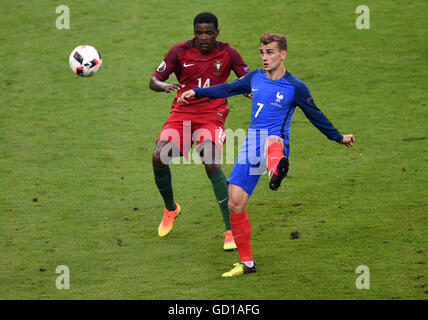 France's Antoine Griezmann (right) and Portugal's William Carvalho battle for the ball during the UEFA Euro 2016 - Stock Photo