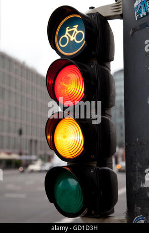 Traffic light showing red and yellow, Potsdamer Platz, Berlin - Stock Photo