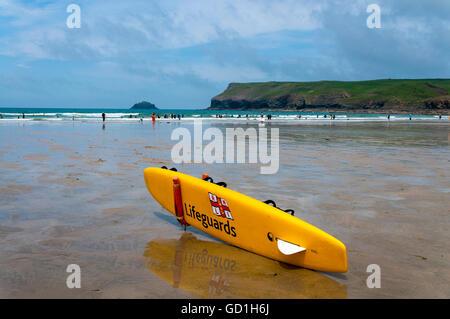 Lifeguards RNLI surfboard on Polzeath beach, Cornwall, England, UK - Stock Photo