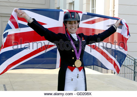 File photo dated 09-08-2012 of Great Britain's Charlotte Dujardin celebrates after winning gold in the Equestrian - Stock Photo