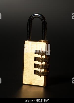 Combination padlock on black background - Stock Photo