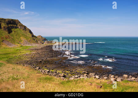 The rocky coast at the Giant's Causeway in Northern Ireland on a bright and sunny day. - Stock Photo